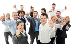 group of happy confident credit union employees placed by financial staffing resources showing thumbs up